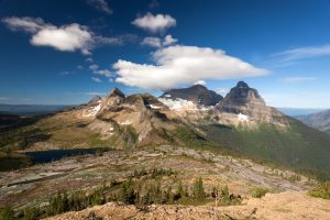"""""""Kinnerly and Kintla"""" Two imposing massifs standing high above Glacier National Park, Montana on the Canadian Border. This image was captured from the summit of Boulder Peak. f/22 @ 1/15 sec using a 17mm lens and a Polarizing Filter. backcountryjourneys.com/blog/2015/11/kinnerly-and-kintla #glacier #montana #photography"""
